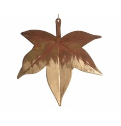 A gold iron hanging decoration in the shape of a sycamore leaf