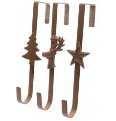 An assortment of 3 iron Christmas wreath hangers with festive designs