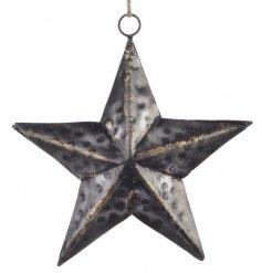 A large hammered metal black star hanging decoration