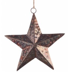 A large copper toned metal star on a rope hanging decoration
