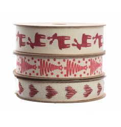 An assortment of 3 cream / red ribbons