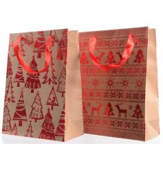 A mix of 2 reindeer and Christmas tree design craft bags with ribbon handles.