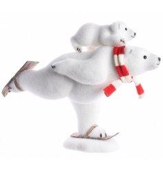 A white foam skiiing polar bear figurine with cub