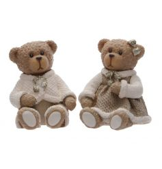A boy and girl sitting bear ornament, each with a smart outfit. A chic and classic decoration for the home.