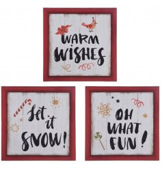 An assortment of 3 Christmas design signs with red rustic frames.