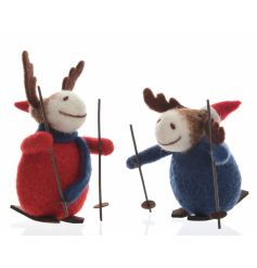 An assortment of 2 adorable wool reindeer decorations with Christmas hats and winter skis.