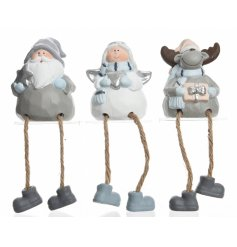 An assortment of 3 blue and grey shelf sitting Christmas figures including a Santa, Angel and Reindeer ornament.