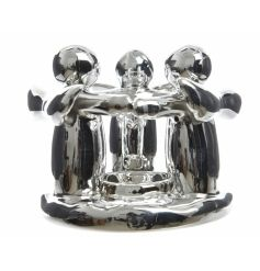 A beautiful silver t-light holder with three hugging angel ornaments surrounding the t-light.