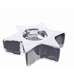 An elegant silver star shaped t-light holder.