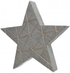 A stylish 3D concrete star with a geometric gold glitter pattern