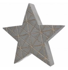 A 3D concrete star decoration with a gold glitter pattern