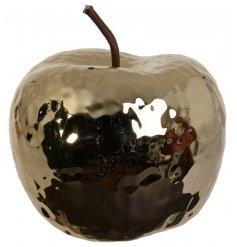 A decorative golden apple ornament