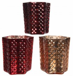A mix of 3 star shaped glass t-light holders in an assortment of rich red and ornate gold colours.