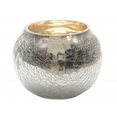 A stylish silver glass t-light holder with a crackle finish. A timeless home accessory.