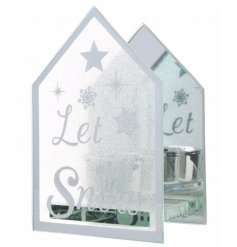A glass mirrored house shaped t-light holder