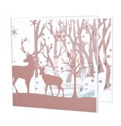 A glass t-light holder with a woodland reindeer scene.