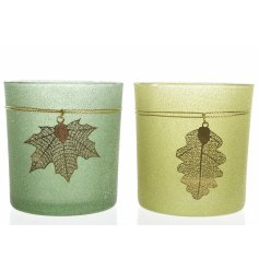 Coloured t-light holders, each with a copper leaf decoration.