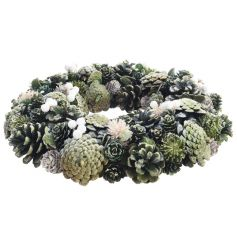 A beautiful traditional round wreath with green bloomed pinecones and artificial leaves and berries.