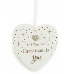 A ceramic heart shaped Christmas slogan plaque with a heart gem detail. A fabulous gift item from the mad dots range.