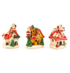 An assortment of 3 light up LED decorations with Santa on roof