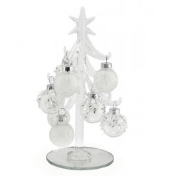A small silver and white frosted christmas tree decoration with baubles