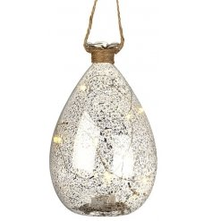 Add to your home that sweet festive glow with these stylish hanging mottled glass balls.
