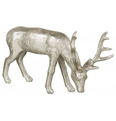 Add a touch of silver glitz to your woodland display with this stylish glitter covered resin reindeer decoration