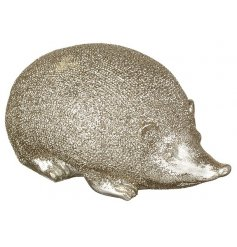 A gold resin hedgehog decoration