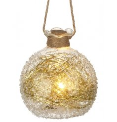 A beautiful warm glowing LED based bauble with a hanging jute rope