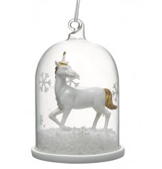 A fabulous little hanging glass dome finished with a white and gold based standing unicorn