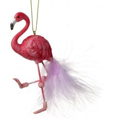 A pink flamingo hanging decoration with feather tail