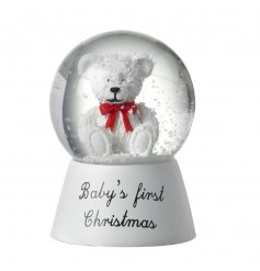 A beautiful resin based snowglobe with a sweet little bear inside and script 'Baby's first Christmas'