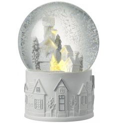 Bring a beautiful warm glow to your home with this delicate light up snow globe