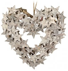 A pretty heart shaped birch wreath with glitter sliver stars.