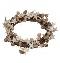 A stylish twig wreath finished with glittered stars and pine cones