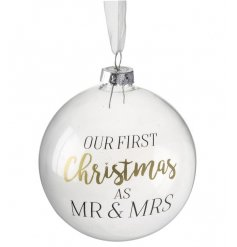 "A beautifully delicate clear glass baubles finished with a script ""Our First Christmas As Mr & Mrs"""