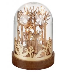 A stunning and unique woodland style decoration. A glass cloche is encasing a wooden woodland scene with LED lights.
