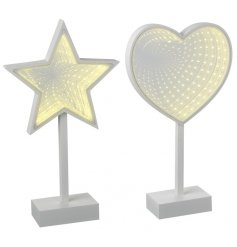 A mix of 2 wooden heart and star mirrors with a light up feature creating a unique 3D holographic effect.