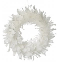 A beautiful white feather wreath with a touch of silver glitter sparkle.