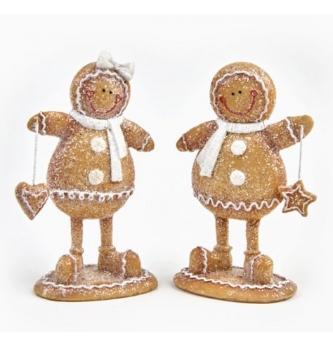 Standing Gingerbread boy and girl ornaments with iced details, star and heart biscuits and winter scarves.