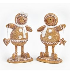 A mix of 2 boy and girl standing gingerbread ornaments with heart and star decorations.