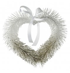 A pretty hanging heart wreath in white and gold with a glitter finish.