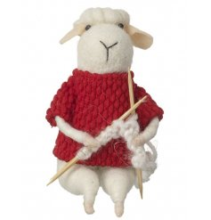 A fun and fabulous felt sheep decoration with a knitted jumper and knitting needles.