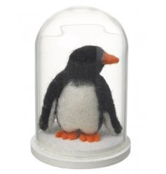 An adorable felt penguin displayed beautifully in a glass dome. A much loved seasonal decoration for the home.