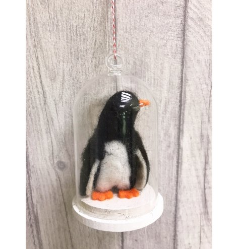 A cute felt penguin decoration stood inside a glass cloche. Complete with a red and white candy cane string hanger.