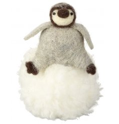 An adorable penguin sat upon a large fluffy snowball. A must have this season!