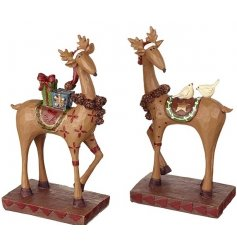 An assortment of 2 quirky standing reindeer figures decorated with Christmas hats, presents and birds.