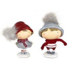 An assortment of two little boy and girl standing figurines in fluffy hats