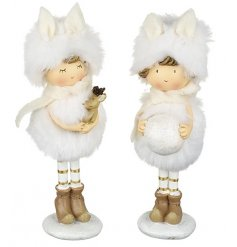 An assortment of 2 white fluffy little girl resin figurines