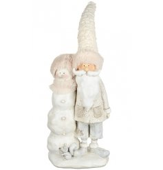 This sweet standing resin santa figure will look great with any Winter Wonderland theme